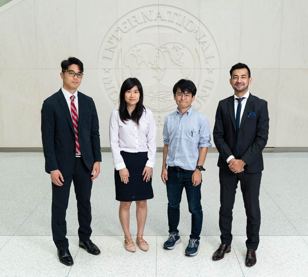 Japan-IMF Scholars Group Photo with Japanese Executive Director Takuji Tanaka at the International Monetary Fund in Washington on August 22, 2019.  IMF Photo/Joshua Roberts